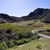 The 16th hole of the Sky Course at Lost Canyons Golf Club is located in the center of the steep canyon.