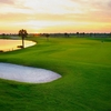 A sunrise view of a green with water coming into play from left (Jason Myers)