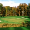 A fall view of green protected by bunkers at Augustine Golf Club
