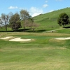 A view of green #3 protected by bunkers at River Island Country Club