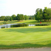 A view the 10th green with water in background at Vassar Golf & Country Club