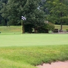 A view of a green protected by a sand trap at Stony Creek Golf Course