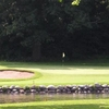 A view over the water of green #4 at Milham Park Golf Course