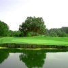 A view over the water of a green at LinRick Golf Course