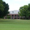 A view of the clubhouse and practice putting green at Huntsville Country Club