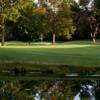 A view of a green surrounded by water at Huntsville Country Club