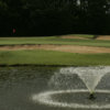 A view of green with water fountain in foreground at Frances E. Miller Memorial Golf Course