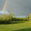 A view of the rainbow over a green at Nemadji Golf Course