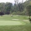 A view of a green guarded by a collection of bunkers from The Links at Hemlock Creek