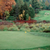 A fall view of a green with a bridge in the background at White from Mistwood Golf Course