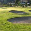 A view of a green protected by bunkers at Metchosin Golf and Country Club
