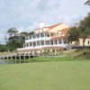 View of the 18th hole with the clubhouse in the back at Brick Landing Plantation