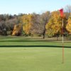 A fall view of a green at Pine Hills Golf Club