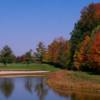 A fall view over the water of a green at The Legends Golf Club