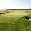 A view of green #9 protected by a collection of bunkers at Tallgrass Country Club