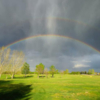 A view of a rainbow over Wainwright Golf and Country Club