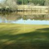 A view of a green with water coming into play at Cedarbrook Country Club
