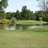 A view over the water of green #14 from Eighteen Course at Riverside Golf Club