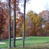 A fall view of a hole guarded by sand traps at Beekman Country Club