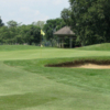 A view of a green protected by a bunker at Streamwood Oaks Golf Club