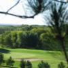 A view of a green protected by a bunker at Afton Alps Golf Course