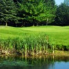 A view over the water of a green at Foxwood Golf Club
