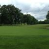 A view of a hole protected by a bunker at Preakness Valley Golf Course