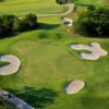 A view of a hole surrounded by a collection of sand traps at Tangle Ridge Golf Club