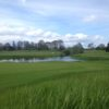 A view of a hole with water in background at The Reserve Vineyards & Golf Club
