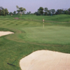 A view of a green protected by sand traps at Turtle Creek Golf Club
