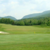 A view of a green protected by sand traps at Linville Falls Golf Club