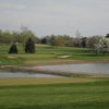 A view of a green with water coming into play at Lone Oak Golf Course