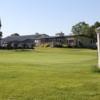 A view of a green and the clubhouse in background at Wingham Golf Club