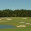 A view of a hole protected by bunkers at Crooked Tree Golf Course