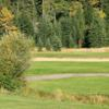A view of a green protected by a bunker at Tomahawk Lake Country Club