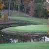 A view of a hole surrounded by water at Vineyard Golf Course