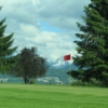 A view of a hole with snowy mountains in background at Cheam Mountain Golf Course