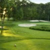 A view of a green surrounded by bunkers at Poplars Golf Club
