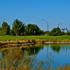 A view of a green with water coming into play at Greenfield Lakes Golf Course
