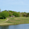 A view of a green protected by bunkers at Natchez Trace Golf Club