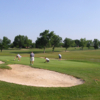 A view of a green protected by bunkers at Maplehurst Country Club
