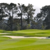 A view of a green protected by bunkers at Monterey Pines Golf Course