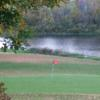 A fall view of a green with water coming into play at Majestic Hills Golf Course