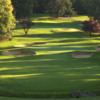View of a green and bunkers at Portland Golf Club
