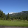 A view of the practice putting green and the driving range in the distance at Plumas Pines Golf Resort