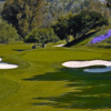 A view of a green with bunkers on sides at Pala Mesa Resort