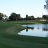 A view from Meadowlark Golf Course with golf carts in background and water on the right