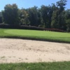 View of a green and bunker at Tanglewood Golf Course