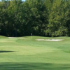 A view of a hole guarded by bunkers at Fox Creek Golf Club