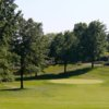 A view of a green protected by bunkers at Rawiga Golf & Swim Club